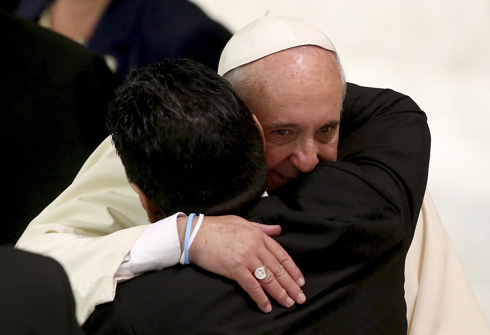 """Former soccer star Maradona hugs Pope Francis during a special audience held before a special interreligious """"Match for Peace"""","""
