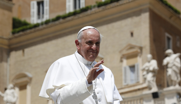 Pope Francis waves at the end of his Wednesday general audience in St Peter's Square at the Vatican