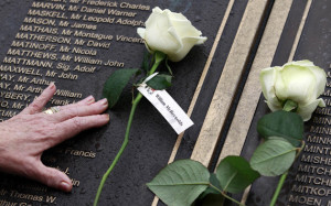 A woman places a rose on the Titanic memorial in Belfast at a service to mark the 101st anniversary of the sinking of the RMS Titanic on the 15th April 1912